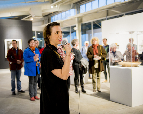 Curator Amy Owen speaking with guests in the Gatehouse Gallery