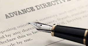 paper titled advance directives with pen on top of it.