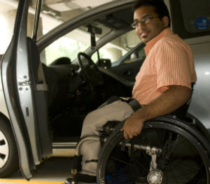 Man transferring to his car from his wheelchair