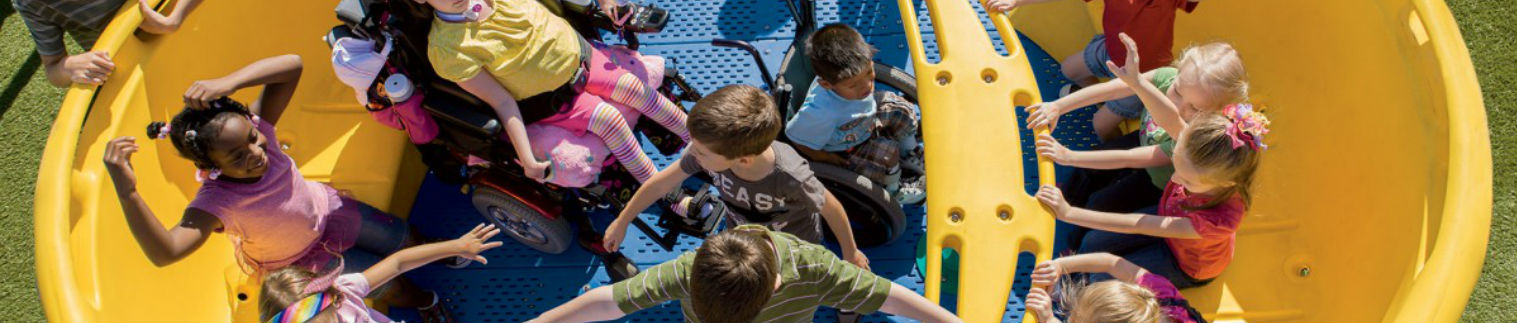 Kids playing on an accessible playground.