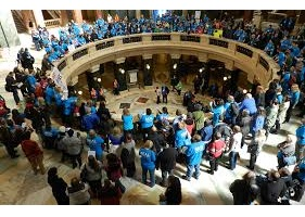 Participants at Disability Advocacy Day gathered around the rotunda balcony in the Capitol
