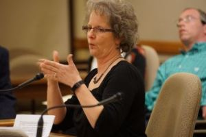 Denise Johnson testifying at public hearing