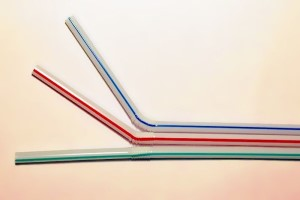 Three plastic drinking straws