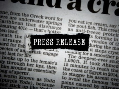 "Newspaper with words ""press release"" in the center"