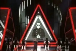 Daddy Yankee under a Masonic compass