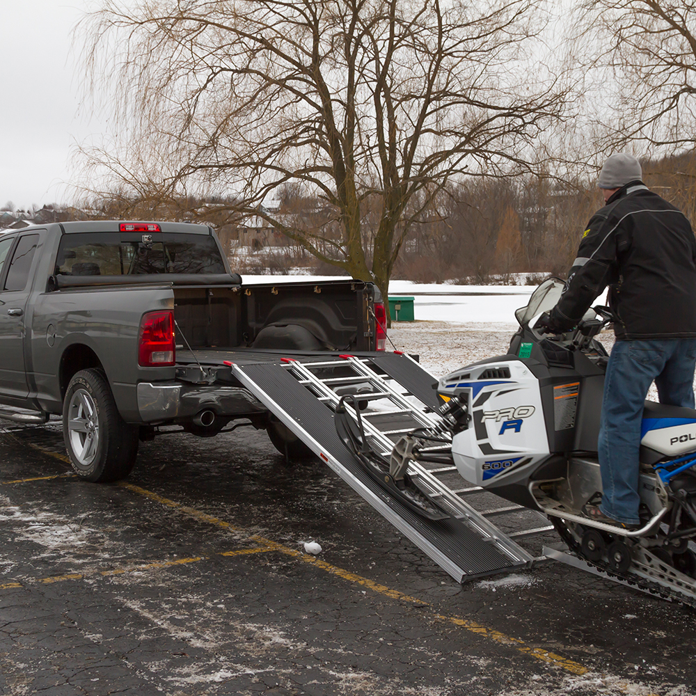 how to load a snowmobile into a truck