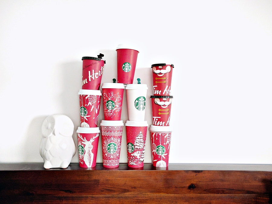 Parenthood in one photo: tower of coffee cups from Tim Horton's and Starbucks