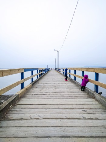 anxiety: pier stretching out to the ocean with two children on it
