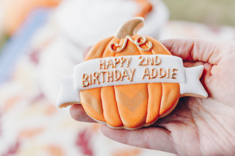 pumpkin patch birthday party, frosted sugar cookie in shape of a pumpkin