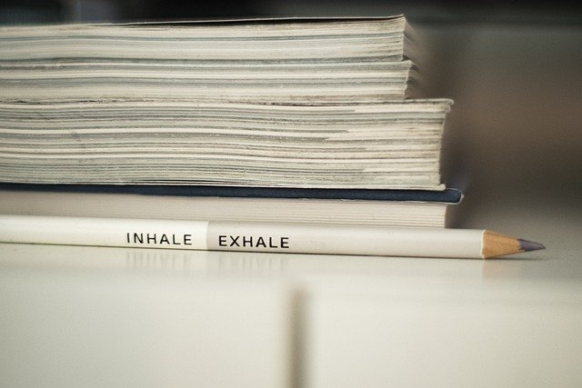 Pencil showing the words inhale and exhale