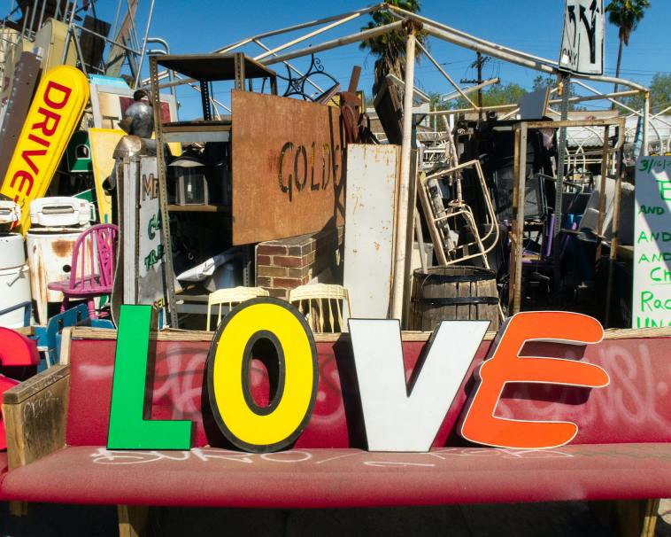 Photo of Metal Junk With Love Written on a Seat