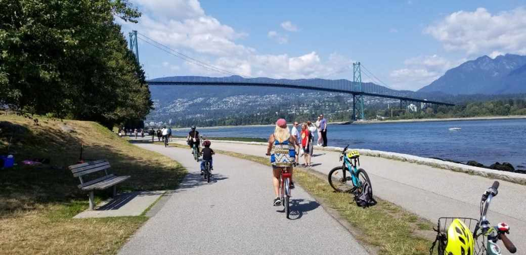Rear view of a girl cycling along the seawall in Stanley Park