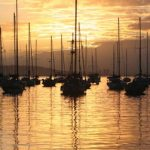 The sun rises over the yachts at Chaguaramas. Photographer: Edison Boodosingh