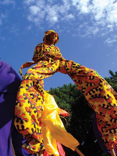 A moko jumbie parades at Independence Day celebrations. Photographer: Edison Boodoosingh