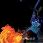 An acrobatic blue devil breathes fire. Photographer: Edison Boodoosingh