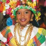 A young celebrant in the Easter Bonnet parade. Photographer: Edison Boodoosingh