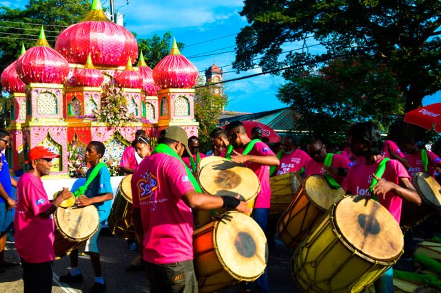 Tassa drummers play in front of a tadjah at Hosay. Photo by Aarti Gosine