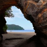 One of the caves at Las Cuevas, looking out over the sand and to the water. Photo by Chris Anderson