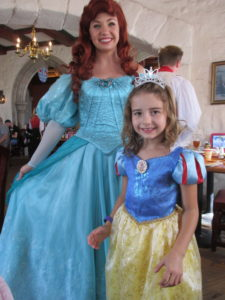 Meet n greet monday princess ariel disfamilytravels in the magic kingdom she can be found at cinderellas royal table this is the character dining that is located in cinderellas castle in the middle of the m4hsunfo