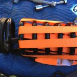 Front suspension: Using ratchet straps in an attempt to compress the spring
