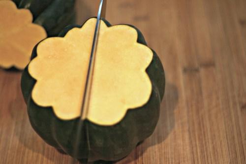 Cut acorn squash in half