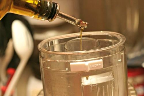 olive oil into food processor