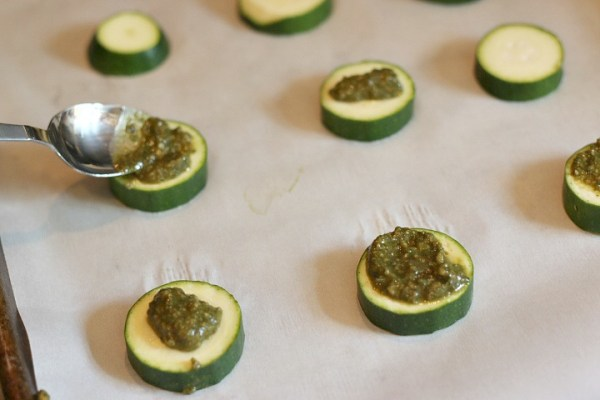pesto on zucchini bites