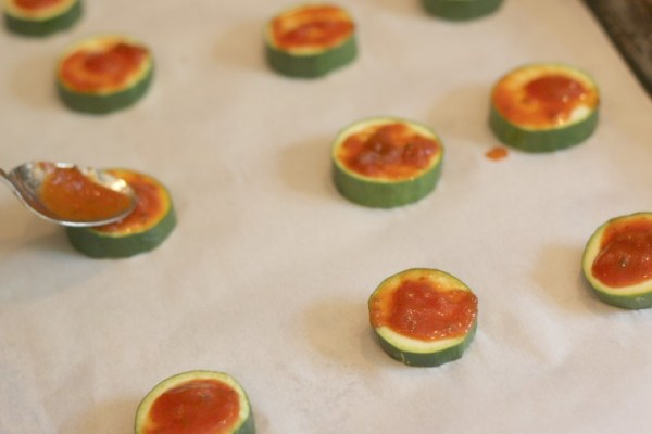spread marinara on zucchini bites