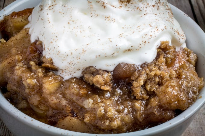 Sweet apples topped with crumbly, buttery oats and slow cooked with cinnamon and brown sugar. Serve warm and top with vanilla ice cream. This Slow Cooker Apple Crisp recipe is so incredibly easy to make, you'll never want to make it in the oven again!