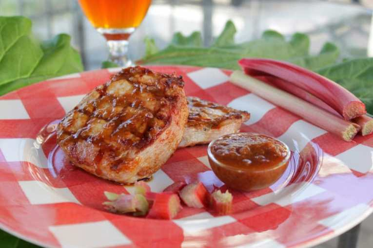 A perfectly grilled pork chop with rhubarb barbecue sauce