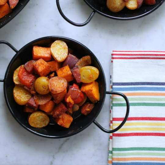 This Little Potato Chorizo and Sweet Potato Hash is the perfect one pan family dinner for those crazy weeknights. An easy 'fix and forget about it' dinner everyone will love! #onepan #chorizohash #dinner