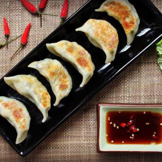 Golden fried dumplings filled with minced shrimp, lentils, and fresh turmeric. #dumplings #turmeric #appys
