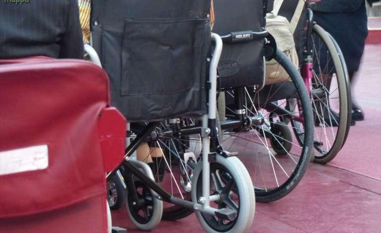 Carrozzine persone disabili nella platea dell'Arena di Verona