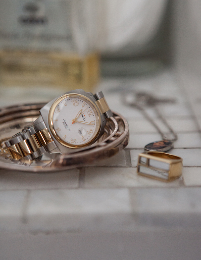 Shinola watch and Aurelie Bidermann mirrored ring