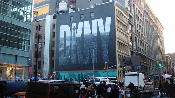 The DKNY mural on houston street NYC was designed by Peter Arnell in the 1990s