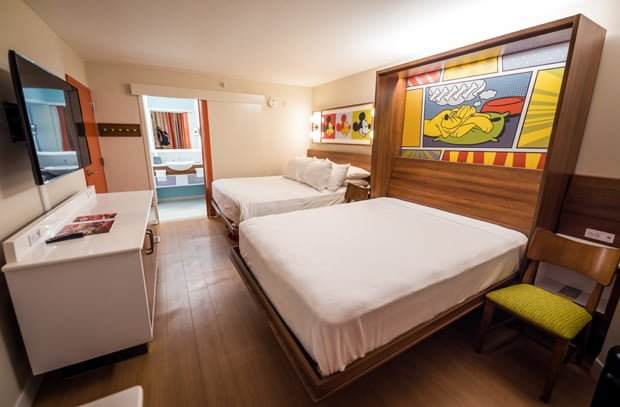 Photos video new rooms at pop century disney tourist blog this room has mickey mouse pop art above the bed which alone gives it as much in the way of disney decor as the previous room it also has pluto art above publicscrutiny Images