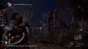 Nioh 2 tir à l'arc à côté d'un moulin