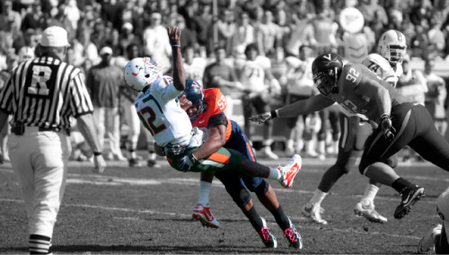 Quarterback Jacory Harris is hit by defensive tackle John-Kevin Dolce at the Miami vs. Virginia game in October.
