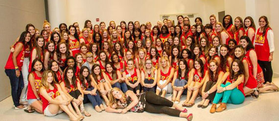 The new sisters of Chi Omega pose with their Pledge Mom