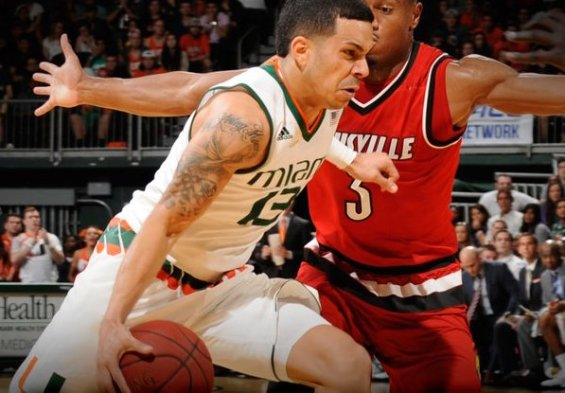 Angel Rodriguez (#13) drives hard to the basket for Miami / @CanesHoops