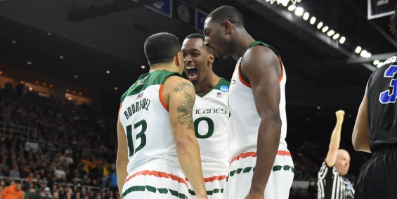 Angel Rodriguez (13), Sheldon McClellan (middle) and Davon Reed (right) celebrate during their 79-72 win against Buffalo / Hurricanesports
