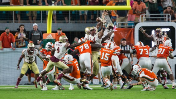 Miami's Michael Badgley has his extra point attempt blocked by Florida State. (Ross Obley)