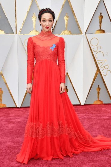 "Ruth Negga, star of ""Loving,"" wearing a red Valentino gown and a blue A.C.L.U. ribbon. Source: Harper's Bazar."
