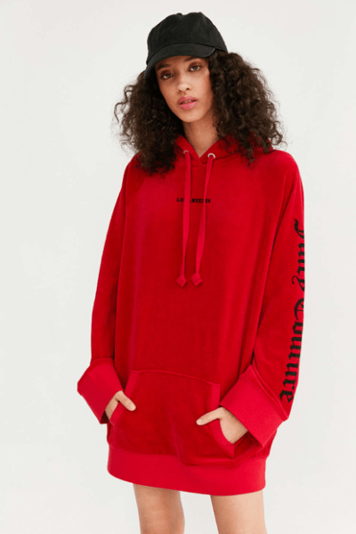 Urban Outfitters model wearing Juicy Couture x Urban Outfitters sweatshirt dress. Source: Urban Outfitters.
