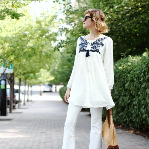 white tunic and cropped denim
