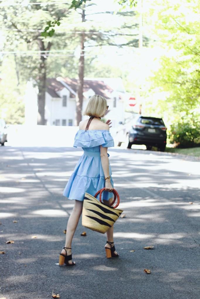 off-the-shoulder dress and straw bag