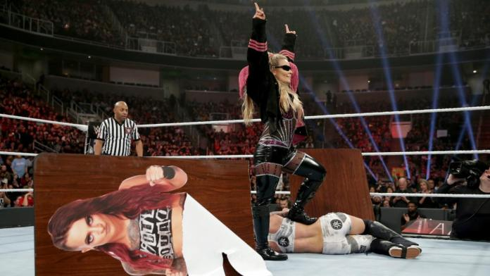 Natalya stands triumphant after defeating Ruby Riott in a Tables Match at WWE TLC