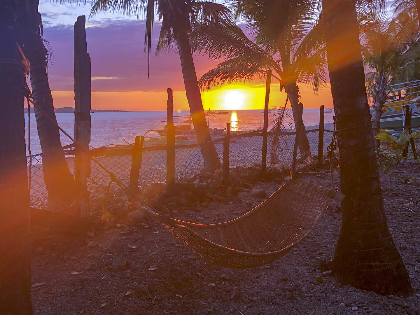 Enjoy a beautiful sunset while laying on a hammock in The Dive House, Anini-y, Antique