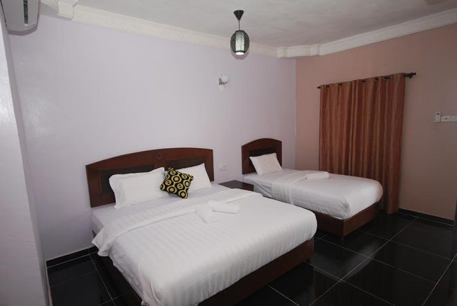 Triple A/C Room at Cozy Inn