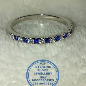 """""""925 Sterling Silver and blue and clear cubics on top Wedding Band or Stack Ring."""""""